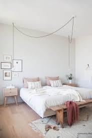 white bedroom with light wood accents and muted pink tones bedroom simple modern bedroom design