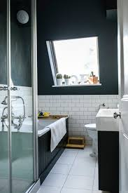 popular cool bathroom color: going dark could help to create a cocooning feel especially in an attic bathroom