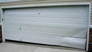 Image result for garage door dents  repair