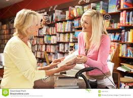 bookshop assistant and the customer stock photos image  female customer in bookshop stock photo