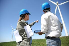 u s wind energy jobs top 100k according to doe report digital wind energy jobs engineers looking at turbine site tablet