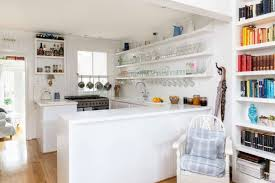 kitchen items store: attractive white floating shelf to store glass kitchen items with unique window hook for terrific kitchen design with classic