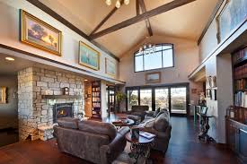 bright cube bookcase in living room rustic with large living room window next to rustic chandelier alongside leather living room furniture and living room big living room furniture