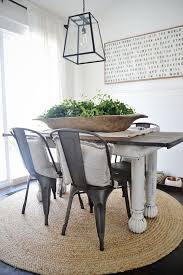 chunky dining table and chairs white wash the bottom of the table natural rug lantern raw wooden centerpiece add upholstered chairs on the end and dinning room