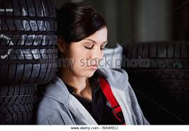 headshot of female mechanic having a nap in garage stock image business nap office relieve