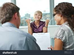 happy w applicant got job by stock photo 47639488 shutterstock happy w applicant got the job by a successful job interview over the shoulder view