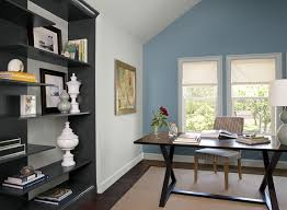 home office with a vibrant aqua blue accent wall blue home office