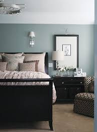 i wish i knew what blue this was but either way good example of black furniture wall color
