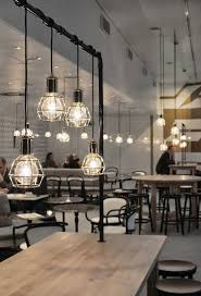 interior from fazer caf in helsinki with work lamps by form us with love for design cafe lighting design