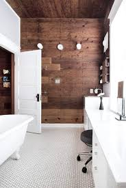 white bathroom with wood accent wall bathroom accent furniture