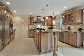 beech wood kitchen cabinets: upscale kitchen with pretty hanging lighting