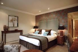 modern bedroom lighting design bedroomspacious bedroom bedside lighting with gold curtain and white headboard decor idea bedroom lighting designs