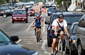 mpls sees surge in residents walking biking to work david joles star tribune in this file photo bicyclists and cars co exist while heading south in heavy traffic along portland ave near e grant street on