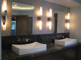 home depot bathroom lighting wall sconces above double sink bathroom vanity and two frameless mirrors bathroom lighting sconces contemporary bathroom