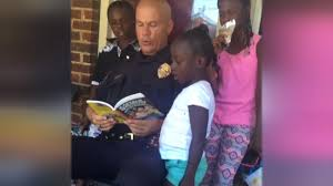 this cop s actions are going viral for all the right reasons aol kind police officer who dances and reads to children will warm your heart