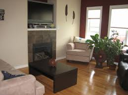 cream couch living room ideas: stone fireplace and tv living room ideas cream sofa small living room