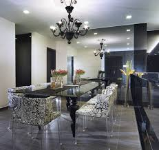 modern eclectic hollywood regency dining room with glossy black chandelier black glossy lacquer dining table and damask dining room chairs with lucite black lacquer dining room