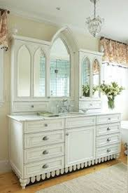 built bathroom vanity design ideas: here  graceful white traditional bath vanity design ideas offer built in multiple arched mirror with long marble top and single under mount sink also plenty drawers and cabinet with oriental handle for trad