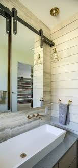 sliding bathroom mirror: love these mirrors frameless beveled mirrors hang from wall mounted sliding tracks when slid to either side the medicine cabinet cavity behind is