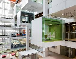 described by the architects as part space station part cathedral and part vertical greek village macquarie banks new design completely reinvents the charming office design sydney