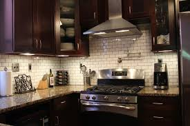 kitchen stainless hoods awesome white backsplash tile contrast with dark wooden kitchen cabine