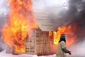 firelance as a wooden hut in flames