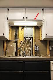 kitchen light upgrade above the sink light cabinet lighting diy