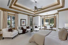 couch bedroom sofa: perhaps the most stunning part of this room is the multiple tiers of tray ceilings with