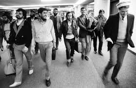 university of nebraska at omaha leo adam biga s my inside stories copythe world herald tom gouttierre at far right leads afghans at the eppley airfield terminal after their arrival in omaha in 1988