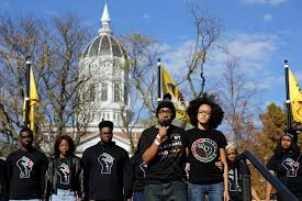 university of missouri encourages students to report hateful and  jonathan butler front left a student who had been hunger striking addresses a crowd following the announcement that university of missouri president tim