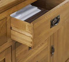 knightsbridge oak is a stunning solid oak furniture range with great detailing curves on edges and tops and a small groove detail on cabinets and table aston solid oak wall mirror
