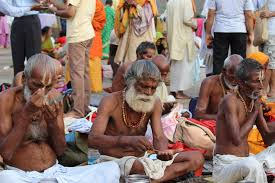 my story i was terribly afraid of the kumbh mela till i finally 10 sadhus apply tilaka made of sandalwood paste 1