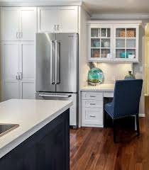 kitchen cabinets home office transitional: built in desk cabinets kitchen beach with beach cottage beach style
