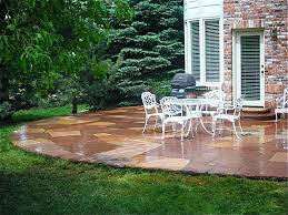 stone patio installation: backyard stone patio pavers ideas flagstone patio installation with white wicker patio furniture for backyard design