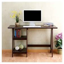 black glass computer desk on white ceramic floor tile closed to