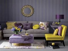 storage solutions living room: stylish living room using stripes wallpaper and yellow purple accents with ottoman storage as storage and coffee table