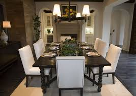 black and white dining table set: open concept home with designated dining area in front of fireplace dark wood dining table