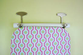 how to hang your ironing board on the wall the easy way young the hooks worked perfectly which was quite a relief since they were the only ones i could that i hoped were big enough to accommodate the wide