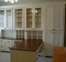 kitchen cabinets home office transitional: home office with wall of built in bookcase transitional den