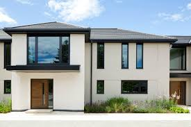 What You Should Know When Choosing A Stucco Finish Capstone - Black window frames for new modern exterior