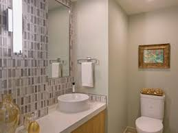 pics of bathroom designs: gold and silver art deco powder room