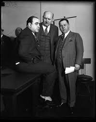 「Al Capone is sentenced to 11 years in prison for tax evasion and fined $80,000,」の画像検索結果