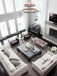 gorgeous living room design with gray walls paint color tv marble fireplace tobacco leather tufted rectangular ottoman sand linen slip covered sofa big living room couches