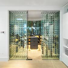st johns wood inspiration for a contemporary wine cellar remodel in london with light hardwood floors box version modern wine cellar