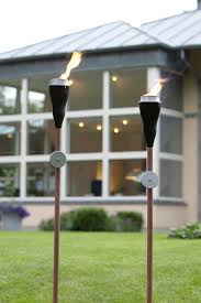 outdoor torch lighting. garden torches give soft elegant light to your backyard outdoor patio ideas torch lighting n
