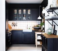modern small kitchen remodel ideas with black painted maple wood kitchen island using wooden countertop and white tiled backsplash as well as glass wall awesome black painted