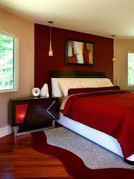 red wall paint black bed: i am loving this romantic bedroom the beige walls and white pillows contrast so well with the strong red elements in the room that accent wall is perfect