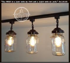 mason jar track lighting a mason jar track light of 3 vintage quarts mason jar light alternating length wagon wheel mason jar