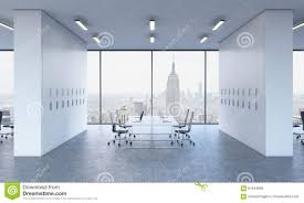 workplaces in a bright modern open space office white tables equipped by modern laptops and bright modern office space