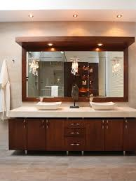 modern interior bathroom modern bathroom interior with two pendant lamps over dark brown ebony wood bathroom vanity cabinet with round metal trough sink bathroom sink lighting